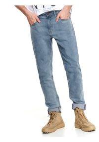 TOP SECRET - Spodnie denim slim fit. Okazja: do pracy, na co dzień. Kolor: niebieski. Materiał: denim. Sezon: lato. Styl: casual