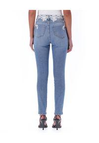 Ermanno Firenze - ERMANNO FIRENZE - Błękitne jeansy z koronkowym zdobieniem. Kolekcja: dla wysokich. Kolor: niebieski. Wzór: aplikacja. Styl: klasyczny
