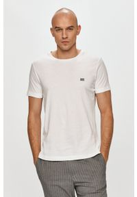 TOMMY HILFIGER - Tommy Hilfiger - T-shirt. Okazja: na co dzień. Kolor: biały. Materiał: dzianina. Wzór: gładki. Styl: casual