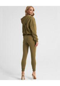 SELF LOVE - Spodnie dresowe w kolorze khaki. Kolor: zielony. Materiał: dresówka. Wzór: nadruk, aplikacja