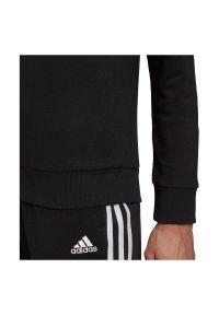 Adidas - Bluza damska adidas Essentials Relaxed Logo Hoodie GM5514. Typ kołnierza: kaptur. Materiał: wiskoza, poliester, materiał, bawełna