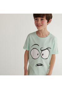 Turkusowy t-shirt Reserved z nadrukiem