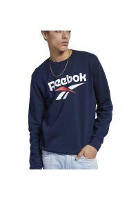 Niebieska bluza Reebok sportowa, z klasycznym kołnierzykiem, długa, z aplikacjami