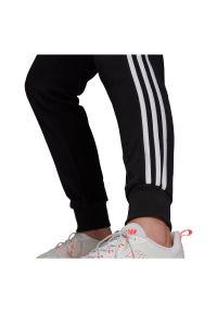 Adidas - Spodnie damskie dresowe adidas Essentials French Terry GM8733. Materiał: dresówka