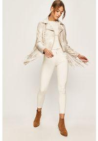 Białe jeansy Desigual z haftami
