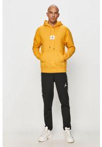 Żółta bluza nierozpinana Jordan z kapturem, casualowa