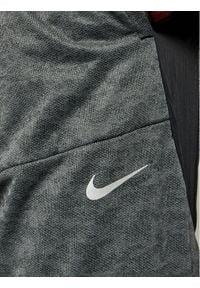 Nike Spodnie dresowe Phenom Elite Wild Run Z9748 Szary Standard Fit. Kolor: szary. Materiał: dresówka. Sport: bieganie
