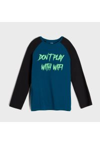 Sinsay - Koszulka z nadrukiem fluorescencyjnym - Turkusowy. Kolor: turkusowy. Wzór: nadruk