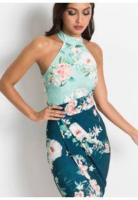 Sukienka z dekoltem halter w kwiaty bonprix ciemnoniebiesko-turkusowy w kwiaty. Typ kołnierza: dekolt halter. Kolor: niebieski. Wzór: kwiaty