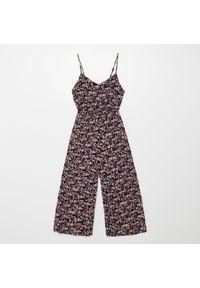 Fioletowe spodnie Cropp w kwiaty