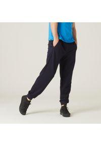 NYAMBA - Spodnie dresowe fitness. Kolor: niebieski. Materiał: poliester, elastan, bawełna, materiał. Sport: fitness