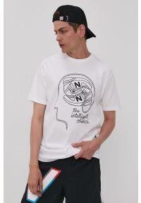 New Balance - T-shirt. Kolor: biały. Materiał: dzianina. Wzór: nadruk