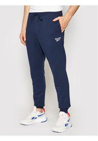 Reebok Spodnie dresowe Identity GL3163 Granatowy Regular Fit. Kolor: niebieski. Materiał: dresówka