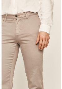 TOMMY HILFIGER - Tommy Hilfiger - Spodnie. Okazja: na co dzień. Kolor: szary. Materiał: tkanina. Wzór: gładki. Styl: casual