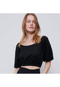 Czarna bluzka Reserved krótka, z dekoltem typu hiszpanka