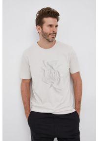 C.P. Company - T-shirt bawełniany. Okazja: na co dzień. Kolor: beżowy. Materiał: bawełna. Wzór: nadruk. Styl: casual