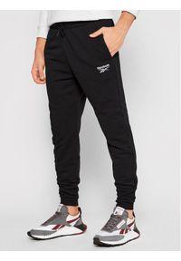 Reebok Spodnie dresowe Identity GJ0554 Czarny Regular Fit. Kolor: czarny. Materiał: dresówka