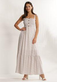 Renee - Kremowa Sukienka Periliria. Typ kołnierza: dekolt kwadratowy. Kolor: beżowy. Materiał: tkanina. Długość rękawa: na ramiączkach. Wzór: kwiaty, aplikacja. Długość: maxi
