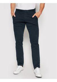 TOMMY HILFIGER - Tommy Hilfiger Spodnie materiałowe Bleecker MW0MW13846 Granatowy Slim Fit. Kolor: niebieski. Materiał: materiał
