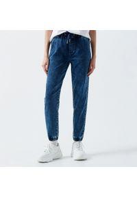 Niebieskie jeansy Cropp #1