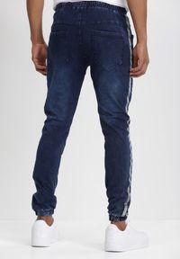 Born2be - Granatowe Spodnie Joggery Pisirise. Kolor: niebieski