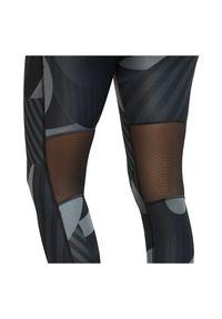 Spodnie do biegania damskie Nike Fast Tight 7/8 Runway CU3114. Materiał: skóra, poliester, materiał. Technologia: Dri-Fit (Nike). Wzór: nadruk