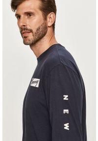 Niebieska koszulka z długim rękawem Tommy Jeans z nadrukiem, casualowa
