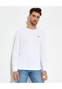 Lacoste - LACOSTE - Biała koszulka z długim rękawem. Kolor: biały. Materiał: prążkowany. Długość rękawa: długi rękaw. Długość: długie