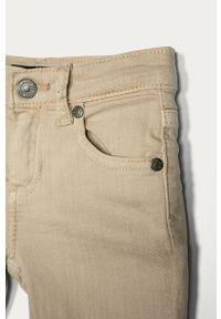 Beżowe jeansy Guess gładkie