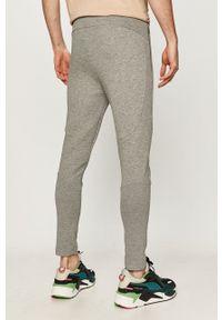 Puma - Spodnie. Kolor: szary