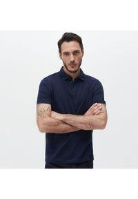 Reserved - Koszulka polo z bawełny organicznej - Granatowy. Typ kołnierza: polo. Kolor: niebieski. Materiał: bawełna