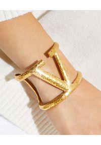 VALENTINO - Bransoleta z VLogo w kolorze złota. Materiał: złote. Kolor: złoty