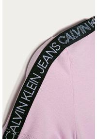 Różowa sukienka Calvin Klein Jeans z aplikacjami, mini, rozkloszowana