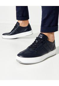 TOD'S - Granatowe sneakersy z monogramem. Nosek buta: okrągły. Kolor: niebieski. Materiał: guma. Wzór: gładki