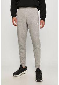 adidas Originals - Spodnie. Okazja: na co dzień. Kolor: szary. Styl: casual