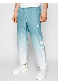 Adidas - adidas Spodnie dresowe adicolor 3D Trefoil 3-Stripes GN3587 Zielony Regular Fit. Kolor: zielony. Materiał: dresówka
