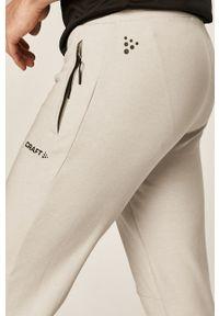 Szare spodnie dresowe Craft
