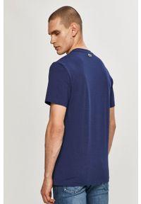Lacoste - T-shirt. Okazja: na co dzień. Kolor: niebieski. Wzór: nadruk. Styl: casual