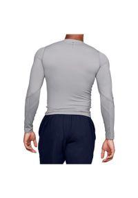 Koszulka męska kompresyjna Under Armour UA Rush LongSleeve 1353447. Materiał: mesh, materiał, elastan, włókno, skóra, poliester. Długość rękawa: długi rękaw. Długość: długie
