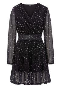 Sukienka z falbaną bonprix czarno-biel wełny w groszki. Kolor: czarny. Materiał: wełna. Wzór: grochy. Styl: elegancki