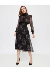 ICON - Czarna sukienka z jedwabiu Joana. Kolor: czarny. Materiał: jedwab. Wzór: aplikacja. Typ sukienki: rozkloszowane. Styl: klasyczny. Długość: midi