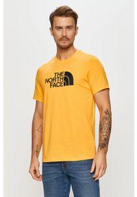 Żółty t-shirt The North Face z nadrukiem, casualowy, na co dzień