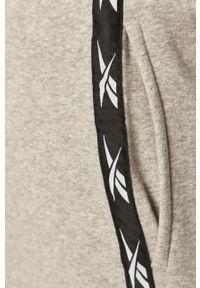 Reebok - Spodnie. Kolor: szary