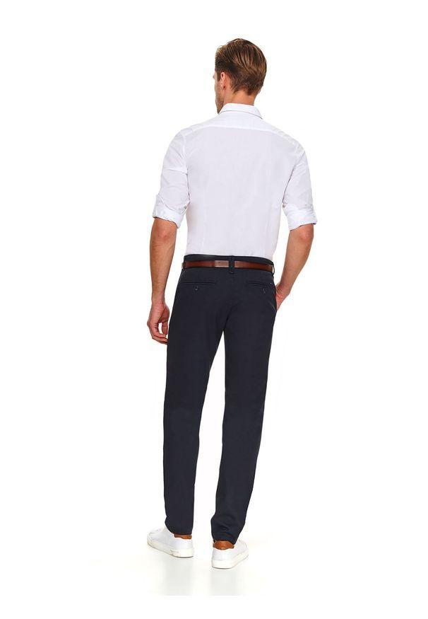 Niebieskie spodnie TOP SECRET klasyczne, w kolorowe wzory, długie