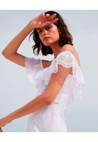 Biała sukienka w koronkowe wzory, asymetryczna