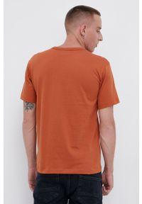 Champion - T-shirt bawełniany. Okazja: na co dzień. Kolor: pomarańczowy. Materiał: bawełna. Wzór: gładki, aplikacja. Styl: casual