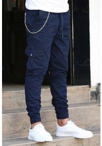 IVET - Spodnie męskie CALEB NAVY. Kolor: niebieski. Materiał: materiał. Styl: sportowy