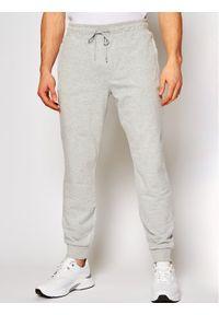 Guess Spodnie dresowe Adam M1RB37 K6ZS1 Szary Slim Fit. Kolor: szary. Materiał: dresówka