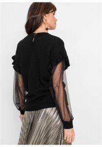 Sweter z falbanami bonprix Sweter z falbanami czarny. Kolor: czarny. Materiał: koronka. Wzór: koronka. Styl: elegancki