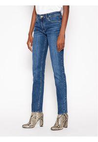 Niebieskie jeansy slim Wrangler #5